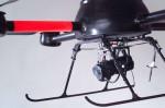 De Microdrone draagt een camera met zich mee