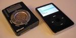 De Rio (32 MB) en een iPod (60 GB) naast elkaar gelegd.
